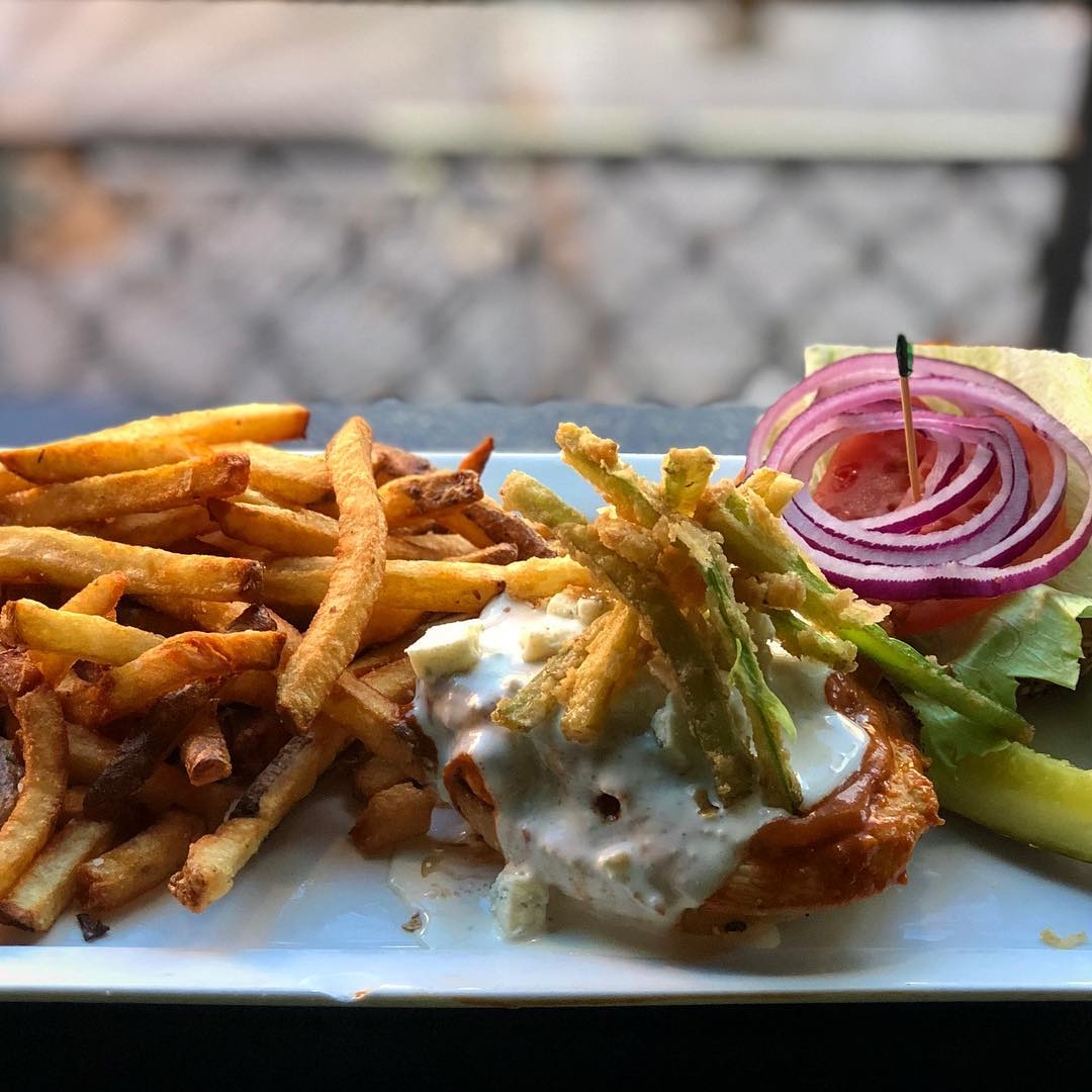 This week's featured sandwich at @localwhiskeybar is the Pompous Bastard! ••• Grilled Chicken Breast tossed in Pompous sauce, Battered Celery, Lettuce, Tomato, Red Onion and Blue Cheese Dressing on a Salt and Pepper Bun! ••• #food #chicken #sandwich #hung